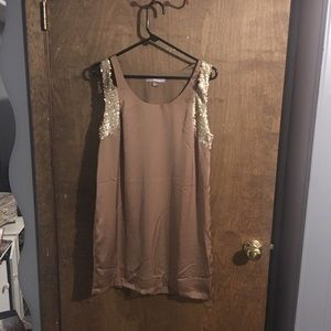 Tan and gold sequin slip dress.
